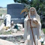 white Santa Muerte in hippie graveyard